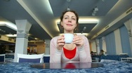 Stock Video Footage of Woman drinks coffee in cafe