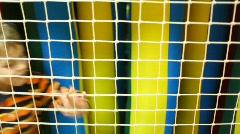 Boy goes beside nets Stock Footage