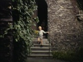 Playing in a monestry garden vintage Stock Footage