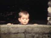 Stock Video Footage of playing hide and seek in the park vintage