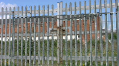 Closed factory gates of a derelict factory building.Northamptonshire England UK - stock footage