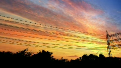 Power pylons at sunset - stock footage