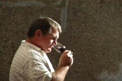 Wine maker tastes wine Stock Footage