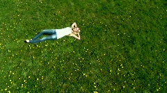 Woman lying on grass - stock footage