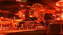 Carnival rides at local fair during night time Stock Footage