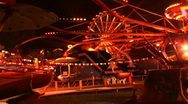 Stock Video Footage of carnival rides at local fair during night time