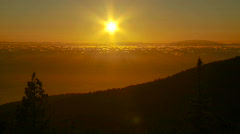 Golden sunset over a distant island. - stock footage