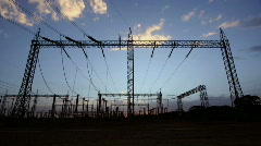 Wide time-lapse of a power station as dusk settles in. Stock Footage