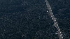 Car drives through lava field. - stock footage