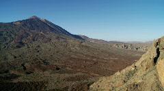Volcano and huge lava field below. - stock footage