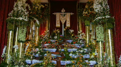 Church display with flowers and cross. - stock footage