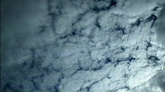 A time-lapse of clouds darkening from an approaching storm Stock Footage