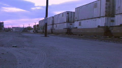 Freight train coming into the city - part 2 Stock Footage
