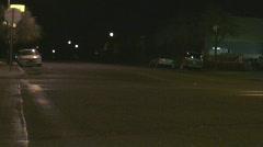 Police car crosses 4 way stop quietly Stock Footage