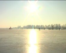 Ice sailing and skating on a cold winterday in the Netherlands Stock Footage