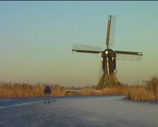 Ice skating on a cold winterday in the Netherlands Stock Footage