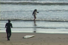 Children and Surfer at Beach Stock Footage