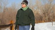 Man walking in snow Stock Footage