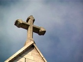 Religious cross with loopable sky background (NTSC) Stock Footage
