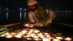 Candles Being Lit On A River Boat In Varanasi India At Night Stock Footage