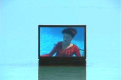 Lovely Brunette Underwater on TV Stock Footage