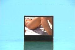 Stock Video Footage of Bikini-clad Brunette on TV-2