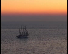 Sailing ship at sunset Stock Footage