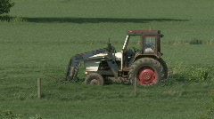 Weeds grow around a disused tractor. Stock Footage
