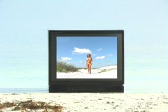 Beautiful Bikini-clad Brunette at the Beach on Television Stock Footage