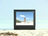Stock Video Footage of Beautiful Bikini-clad Brunette at the Beach on Television