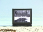 Snowy Scene on a TV Sitting on the Beach Stock Footage