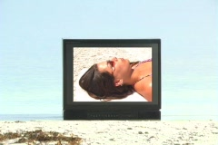 Beautiful Brunette on TV at the Beach-1 Stock Footage