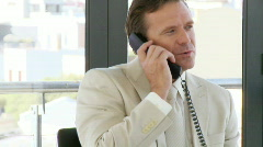 The ultimate businessman on the phone Stock Footage