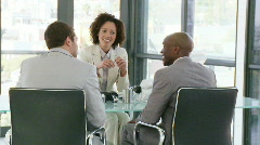 Three businesspeople talking about a project Stock Footage