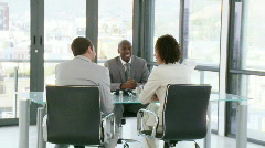 Three successful people talking about bussiness on a desk Stock Footage
