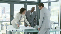 Three powerful businesspeople talking about an action  plan Stock Footage
