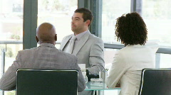 Three smart businesspeople laughting in a meeting Stock Footage