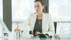 Businesswoman working in her office Stock Footage