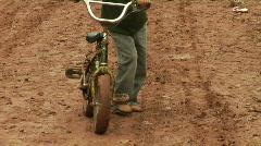 Kid Bicycle mud Stock Footage