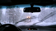 Car moving though snow - stock footage
