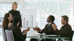 Confident businessteam clapping after a presentation Stock Footage