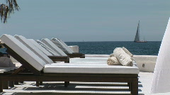 HD1080i Hotel terrasse with white empty sunloungers. Blue sea in background. Stock Footage