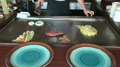 Hibachi chef builds an onion volcano Stock Footage