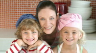 Mother with her Children in the Kitchen Stock Footage