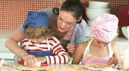 Mother with their children in her Kitchen Stock Footage