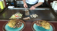 Hibachi chef adds shrimp Stock Footage