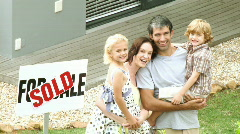 Young family in front of their house Stock Footage