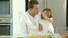 Patient Father and cranky daughter have breakfast - stock footage
