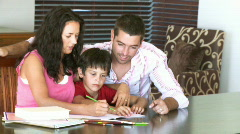 Parents helping their son with homework Stock Footage