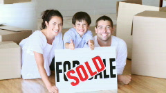 Family happy about her new house - stock footage